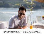 handsome man with sunglasses... | Shutterstock . vector #1167383968