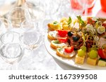 solemn banquet. lot of glasses... | Shutterstock . vector #1167399508