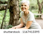 senior woman in the nice forest ...   Shutterstock . vector #1167413395