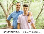 father having fun in forest... | Shutterstock . vector #1167413518