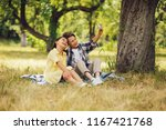 little boy and girl taking... | Shutterstock . vector #1167421768