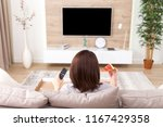 single woman eating pizza and... | Shutterstock . vector #1167429358