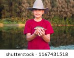 young fisherman with heat... | Shutterstock . vector #1167431518