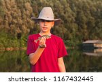 young fisherman with heat... | Shutterstock . vector #1167432445