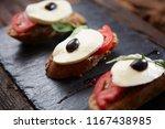 italian bruschetta with chopped ... | Shutterstock . vector #1167438985