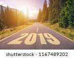 empty asphalt road and new year ... | Shutterstock . vector #1167489202