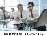 business team at workplace in... | Shutterstock . vector #1167494542