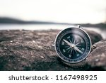 compass on rock in the nature ... | Shutterstock . vector #1167498925