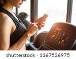 woman using smart phone when... | Shutterstock . vector #1167526975