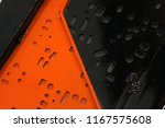 black and orange perforated... | Shutterstock . vector #1167575608