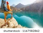 wanderlust time. man hiking in... | Shutterstock . vector #1167582862