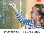 schoolgirl standing near... | Shutterstock . vector #1167612802