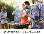 friends enjoying bbq party | Shutterstock . vector #1167623185