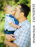 child with father | Shutterstock . vector #1167630925