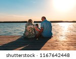 grandparents with grandson... | Shutterstock . vector #1167642448