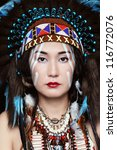 Small photo of Young woman in costume of American Indian