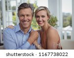 portrait of smiling couple... | Shutterstock . vector #1167738022