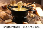 cheese fondue and bread | Shutterstock . vector #1167758128