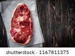 piece of raw lamb meat on dark... | Shutterstock . vector #1167811375