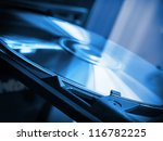Disk in dvd rom in blue colors