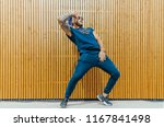 young man with blue dreadlocks... | Shutterstock . vector #1167841498