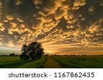Mammatus Clouds At The Back Of...