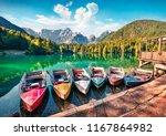 six pleasure boats on fusine... | Shutterstock . vector #1167864982