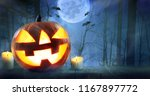 halloween pumpkins against...   Shutterstock . vector #1167897772