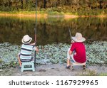 two little boys fishing on the... | Shutterstock . vector #1167929965