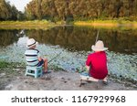 two little boys fishing on the... | Shutterstock . vector #1167929968
