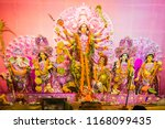 goddess durga idol at decorated ... | Shutterstock . vector #1168099435