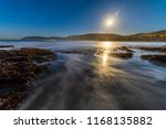 full moon reflections on sea... | Shutterstock . vector #1168135882