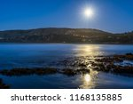 full moon reflections on sea... | Shutterstock . vector #1168135885