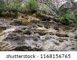 rocky coast. a stony cliff. a... | Shutterstock . vector #1168156765