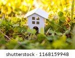 miniature white toy model house ... | Shutterstock . vector #1168159948
