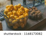metal mesh bucket with lemons... | Shutterstock . vector #1168173082