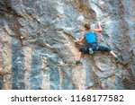 the girl climbs the rock. the... | Shutterstock . vector #1168177582