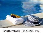 sun hat  towel  sunscreen by...   Shutterstock . vector #1168200442