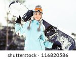 Young Woman Holding Snowboard...