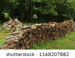 long stack of firewood | Shutterstock . vector #1168207882