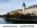 """Small photo of Autumn embankment of the river Seine (Quai des Orfevres). View on the Ile de la Cite """"Island of Paris"""". Paris, France"""