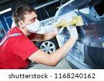auto repairman grinding... | Shutterstock . vector #1168240162