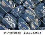 stone gabion with grey stones | Shutterstock . vector #1168252585