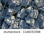 stone gabion with grey stones | Shutterstock . vector #1168252588
