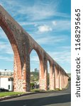 old aqueduct in the city of... | Shutterstock . vector #1168295665