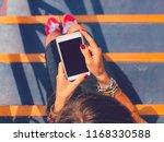 woman using cellphone  ... | Shutterstock . vector #1168330588
