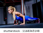 young athletic girl in gym.... | Shutterstock . vector #1168365148