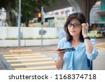 young girl using smartphone on... | Shutterstock . vector #1168374718