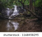 rain forest and waterfall... | Shutterstock . vector #1168458295
