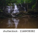 rain forest and waterfall... | Shutterstock . vector #1168458382